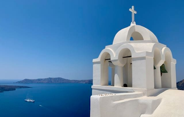 Hotel in Fira with view of caldera and church.