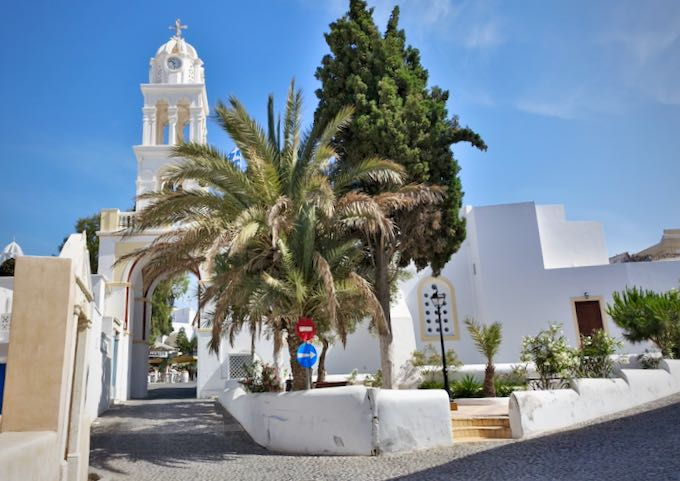 Traditional church and entrance to the traditional Santorinian village of Megalochori