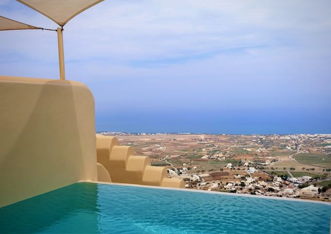 View from an infinity pool over the countryside to the sea