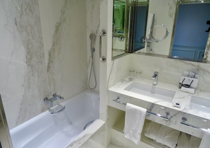 The marble bathrooms are modern.
