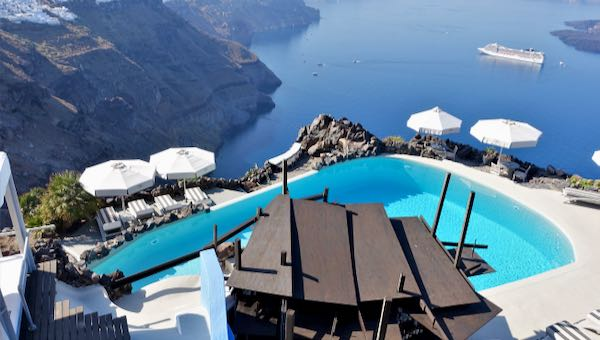 Hotel with infinity pool view of caldera in Santorini.