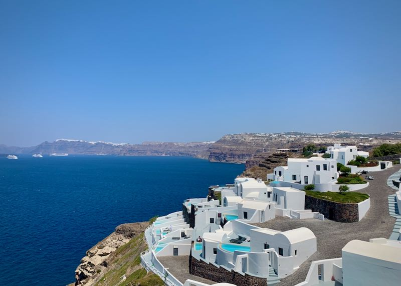 Group of white, Cycladic-style villas on the edge of the Santorini caldera