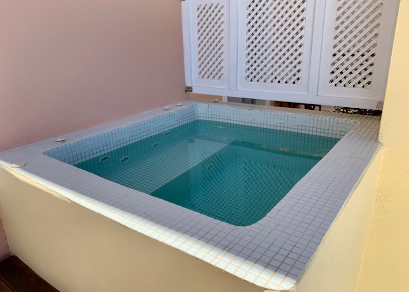 Cori Rigas Suites Fira heated outdoor jacuzzi.