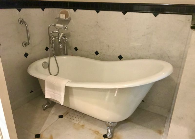 The bathroom has a standalone tub.