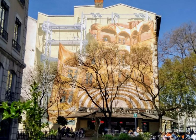 A huge mural is above René Nardone's ice cream parlor.