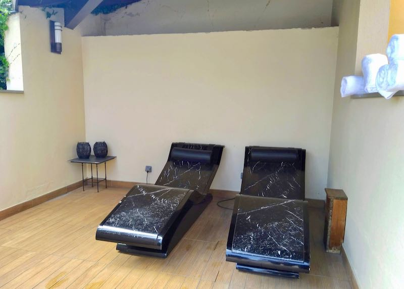 There are 2 heated marble chaise longues.
