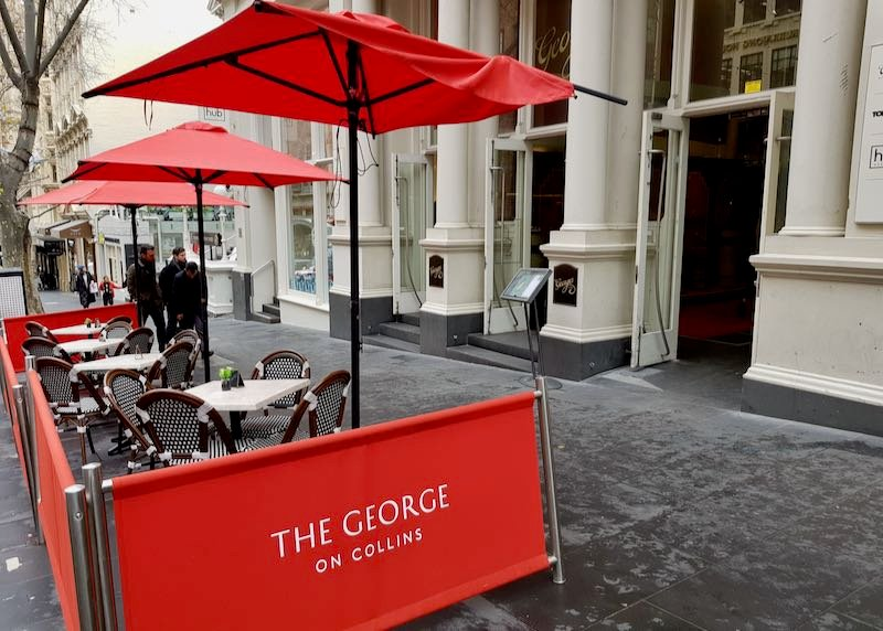 The George on Collins offers outdoor seating.