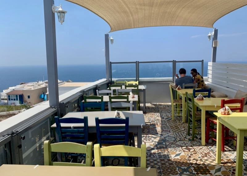 Rooftop patio with water view at Elinikon restaurant in Oia Santorini 2