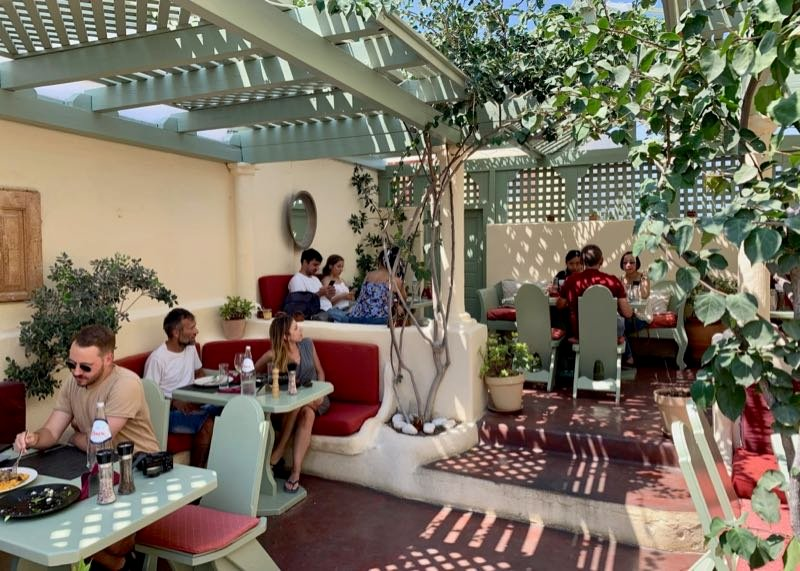Outdoor dining at at Karma restaurant in Oia