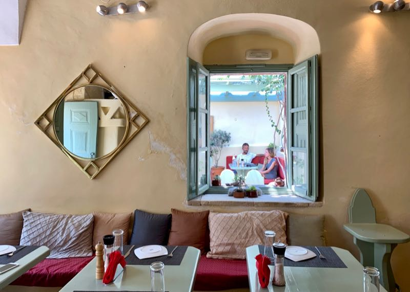 Looking out through window at at Karma restaurant in Oia