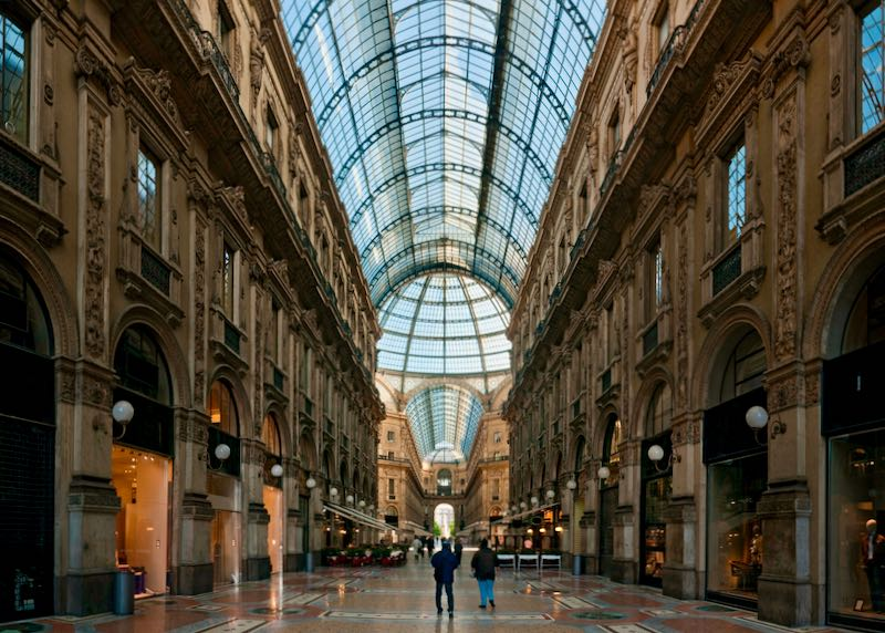 Tourists gaze at the towering glass dome of the Galleria Vittorio Emanuele shopping mall