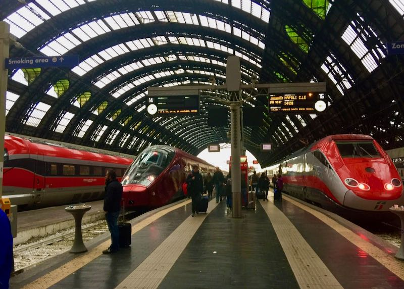 Trains wait on the platform at Milano Centrale Station