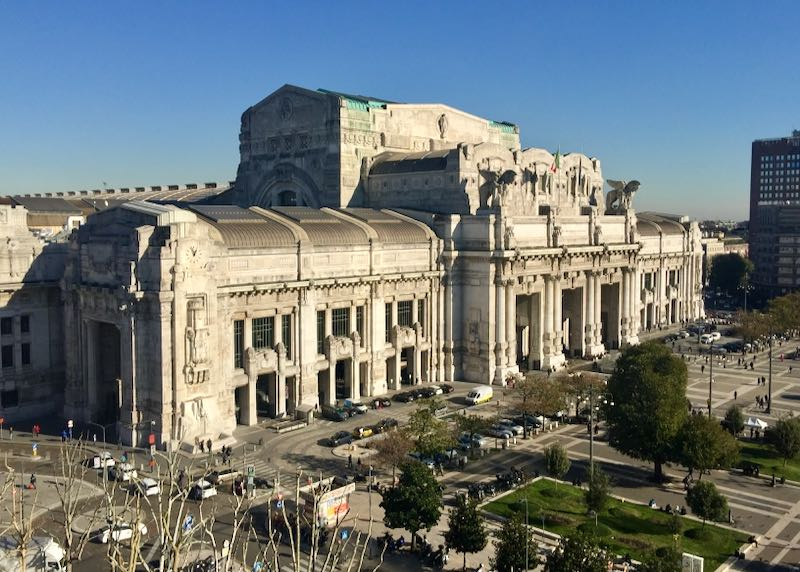 Exterior of Milano Centrale Train Station from a distance on a sunny day