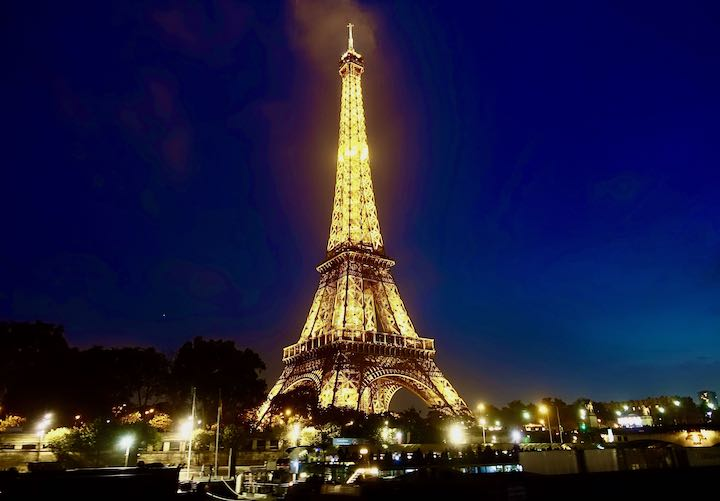 The Eiffel Tower lit up at night in the 7th arrondissement