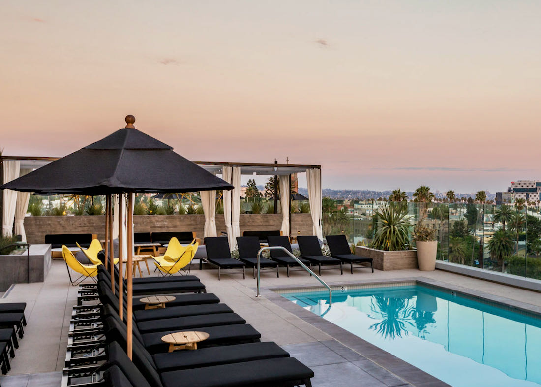 Los Angeles luxury hotel with pool and view.
