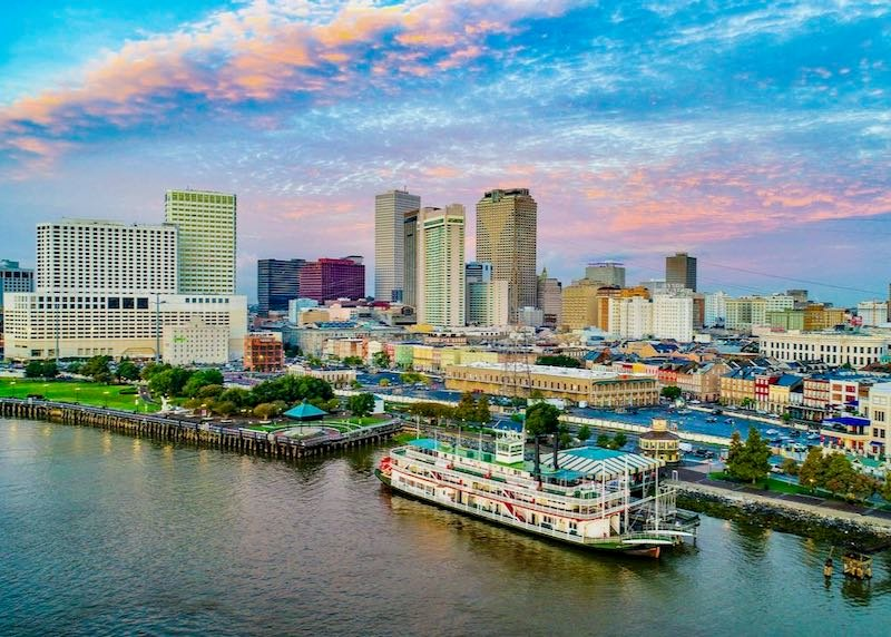 New Orleans cityscape with a steamboat.