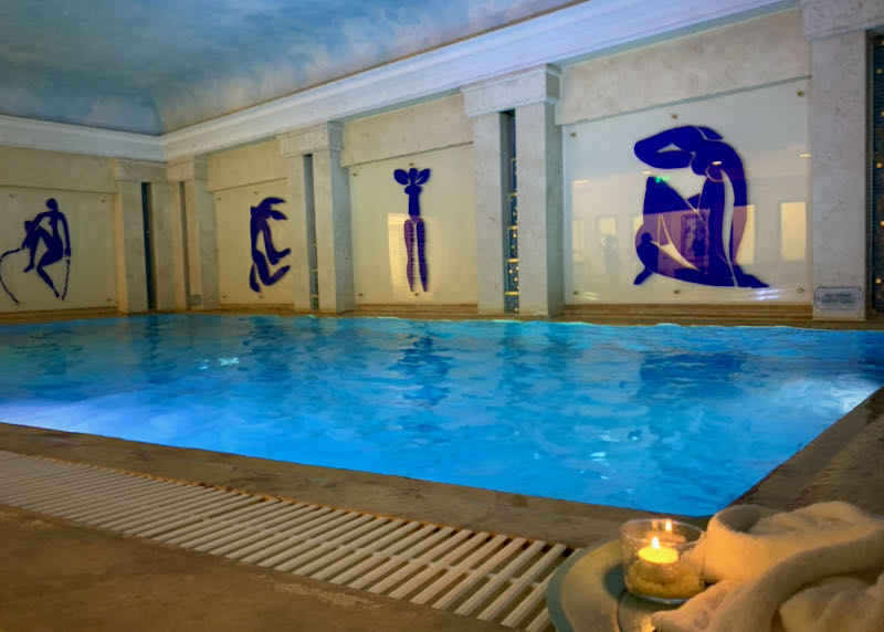 Indoor pool with mosaics on the wall