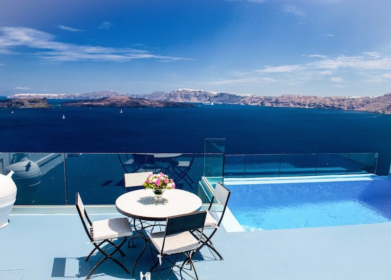 Astarte Suite terrace with infinity pool and view