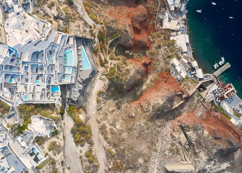 Aerial view of Charisma Suites and Ammoudi Bay in Oia