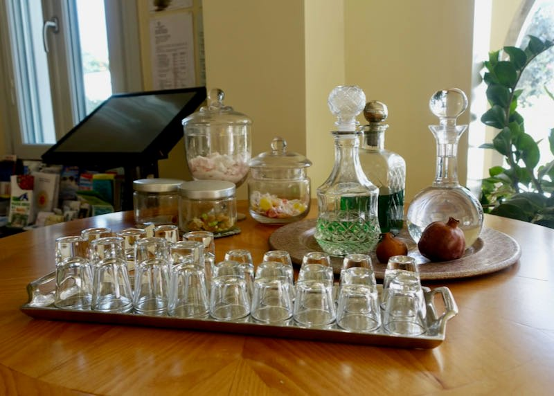 Tray with small glasses and a variety of spirits