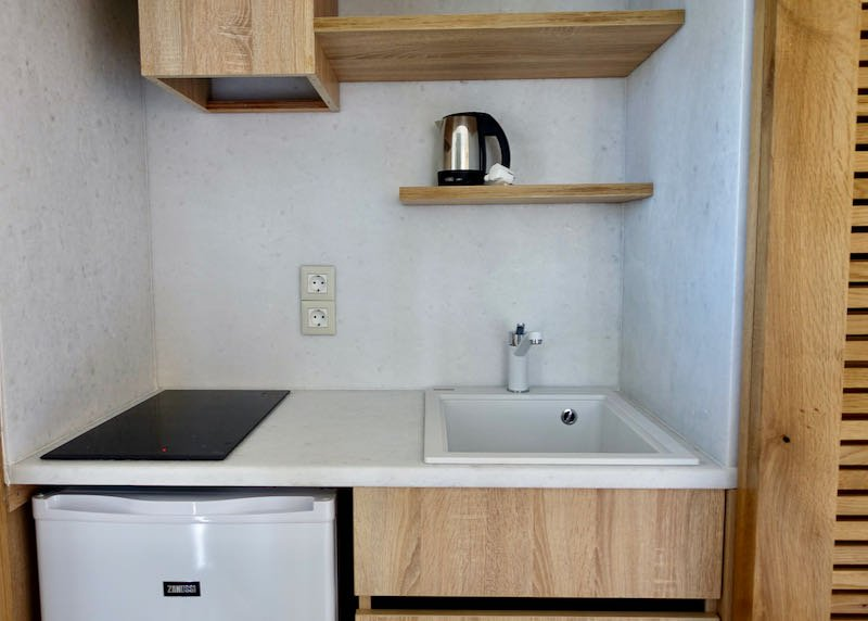 Closet kitchenette with a sink, hotplate, and refrigerator