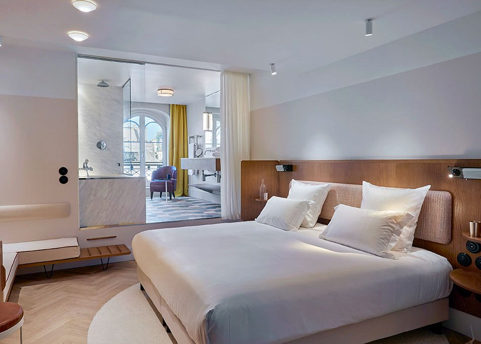 Hotel suite split over two floors with a spacious bedroom and separate bathroom and sitting area