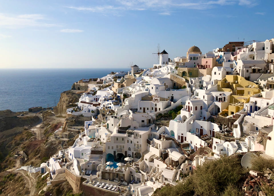 White Cycladic hotels spilll down the rocky cliffs of Oia, Santorini